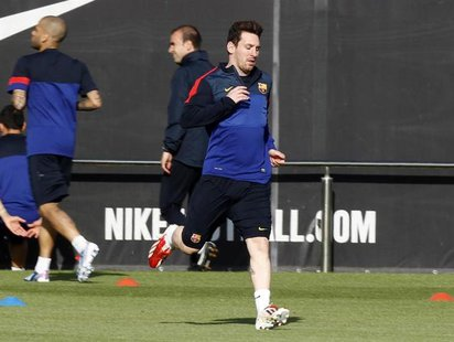 Barcelona's Lionel Messi runs on the pitch during a training session at Ciutat Esportiva Joan Gamper in Sant Joan Despi, near Barcelona Apri