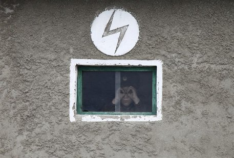 A North Korean soldier looks out of the window of a guard tower, on the banks of Yalu River, about 100 km (62 miles) from the North Korean t