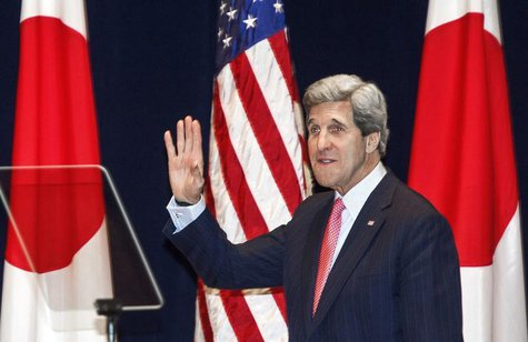 U.S. Secretary of State John Kerry waves to the crowd as he enters the auditorium to deliver a policy speech at the Tokyo Institute of Techn