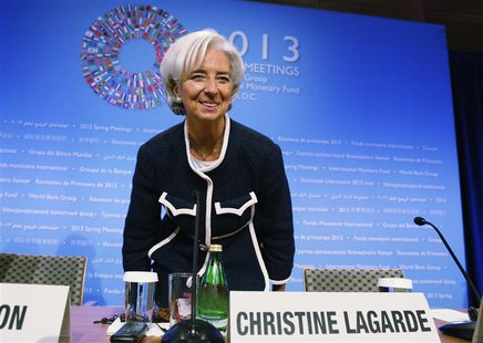 Christine Lagarde, Managing Director of the International Monetary Fund (IMF), takes her seat as she arrives for her opening news conference
