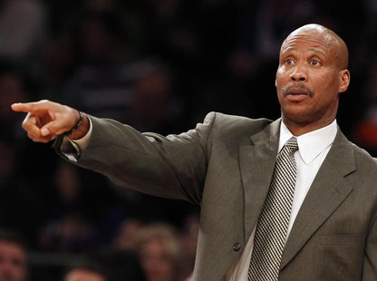Cleveland Cavaliers head coach Byron Scott gives instructions to his team during the fourth quarter of their NBA basketball game against the