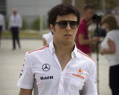 McLaren Formula One driver Sergio Perez of Mexico arrives in the paddock at the Bahrain International Circuit April 18, 2013. REUTERS/Caren