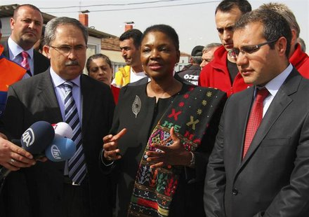 Valerie Amos (C), Under-Secretary-General and Emergency Relief Coordinator at the United Nations Office for the Coordination of Humanitarian