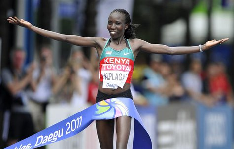 Edna Kiplagat of Kenya celebrates as she wins the women's marathon final at the IAAF World Championships in Daegu August 27, 2011. REUTERS/D