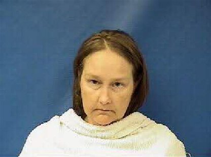 Kim Williams, the wife of the former Kaufman County, Texas, justice of the peace, is shown in this booking photo released on April 17, 2013.