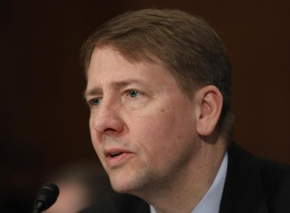 Richard Cordray, Director of the Consumer Financial Protection Bureau, testifies before the Senate Banking, Housing and Urban Affairs Commit