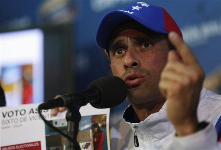 Venezuela's opposition leader Henrique Capriles speaks during a news conference in Caracas April 16, 2013. REUTERS/Tomas Bravo