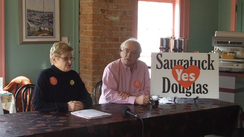 Bobby Gaunt (L) and Travis Randolph (R) discuss their efforts to consolidate Saugatuck & Douglas during a press briefing on Apr. 1, 2013