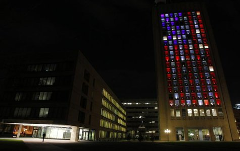A building at the Massachusetts Institute of Technology is lit up in red, white and blue as a tribute to those who were killed or injured in