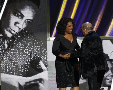 Oprah Winfrey speaks with Quincy Jones after his speech at the 2013 Rock and Roll Hall of Fame induction ceremony in Los Angeles April 18, 2