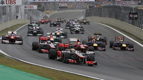 McLaren Formula One driver Lewis Hamilton of Britain (FRONT) drives ahead of the pack at the start of the Brazilian F1 Grand Prix at Interla