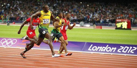 Jamaica's Usain Bolt, in lane 7, pulls ahead to win the men's 100m final during the London 2012 Olympic Games at the Olympic stadium in Lond