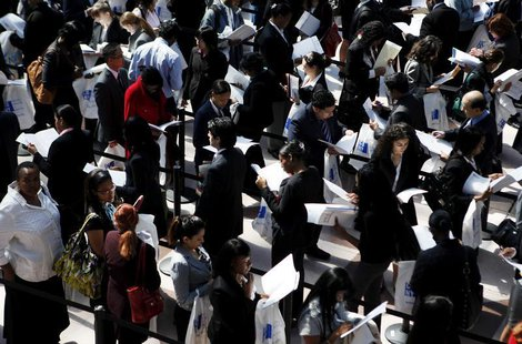 People wait in line to enter the City University of New York (CUNY) Big Apple job fair in New York, April 23, 2010. REUTERS/Shannon Stapleto