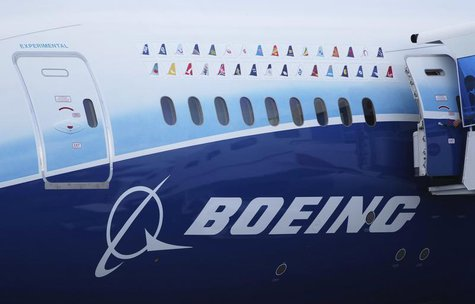 Logos of some Boeing 787 commercial airline clients are seen on a fuselage of the aircraft at the Singapore Airshow in Singapore February 14