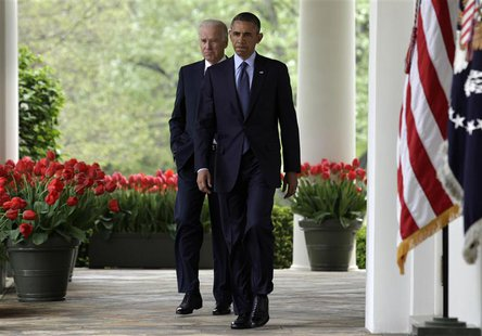 U.S. President Barack Obama (R) arrives with Vice President Joe Biden to deliver a statement on commonsense measures to reduce gun violence,