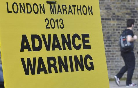 A road closure sign is seen placed along The Mall, the location for the London Marathon finish line, in central London April 16, 2013. REUTE