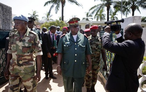 Guinea-Bissau armed forces head General Antonio Indjai (C) leaves a high-level diplomatic meeting at the presidency in the capital Bissau, N