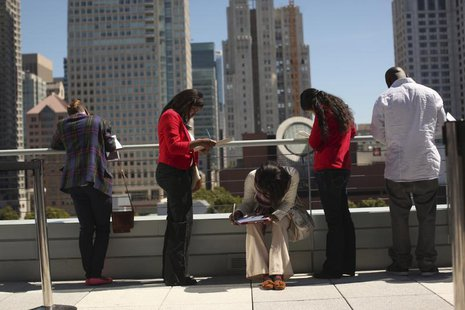 Job seekers apply for the 300 available positions at a new Target retail store in San Francisco, California August 9, 2012. REUTERS/Robert G