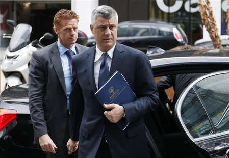 Kosovo's Prime Minister Hashim Thaci (C) arrives for a meeting with Serbian Prime Minister Ivica Dacic (not pictured) and European Union for