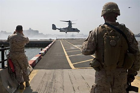 The V-22 Osprey arrives for the Marines from the 1st Battalion 9th Marines Charlie Company 2nd Platoon during a tactical demonstration as a