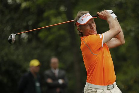 Bernhard Langer of Germany hits his tee shot on the second hole during final round play in the 2013 Masters golf tournament at the Augusta N