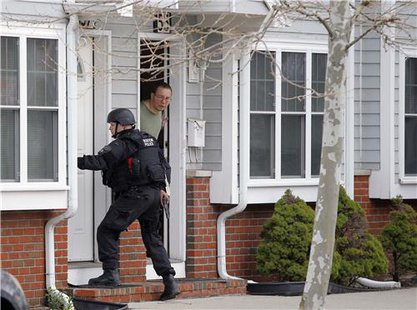 Police search door to door in Watertown, MA  (Reuters)