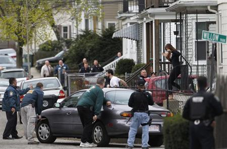 Boston area police officers search home