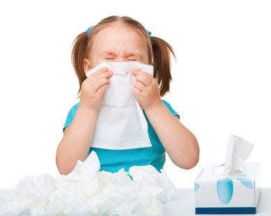 girl with tissues cold and flu