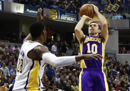 Los Angeles Lakers guard Steve Nash (10) of Canada shoots the basketball over Indiana Pacers center Ian Mahinmi of France during the first h