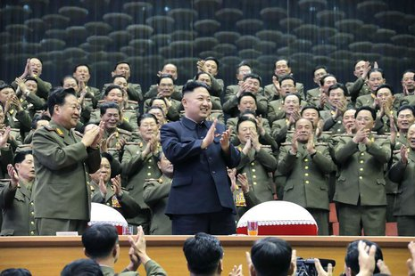 Military officials applaud together with North Korean leader Kim Jong-un, during the Unhasu concert in Pyongyang, in this picture released b