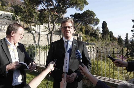 Germany's Foreign Minister Guido Westerwelle (C) speaks with the media before a meeting with the Friends of Syria group in Istanbul April 20