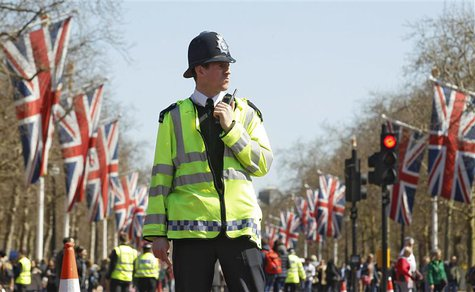 A police officer patrols the Mall a day before the London Marathon April 20, 2013.REUTERS/Luke MacGregor