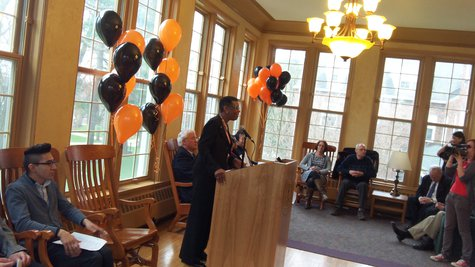 Kalamazoo College President Eileen Wilson-Oyelaran addresses the gathering in the sun room at Trowbridge Hall