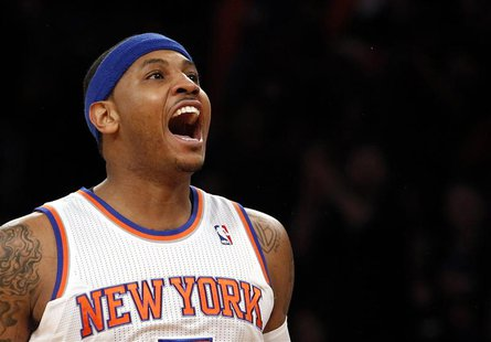 New York Knicks forward Carmelo Anthony reacts after hitting a three-point shot against the Boston Celtics in the first quarter of Game 1 of