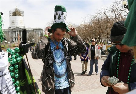 A participant at the 4/20 marijuana holiday buys a hat depicting marijuana plants in Civic Center Park in downtown Denver April 20, 2013. RE