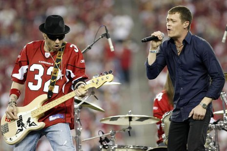 "Brad Arnold (R) and Todd Harrell of the rock band ""3 Doors Down"" perform at halftime during NFL Wild-Card Round playoff football game with t"