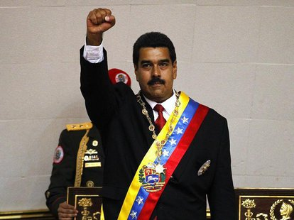 Venezuela's President Nicolas Maduro gestures after being sworn into office in Caracas April 19, 2013. REUTERS/Carlos Garcia Rawlins