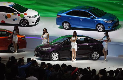 Models pose by Toyota cars during the 15th Shanghai International Automobile Industry Exhibition in Shanghai April 21, 2013. REUTERS/Carlos