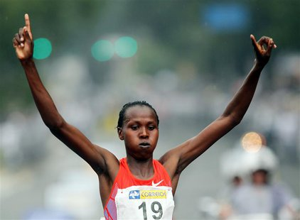 Jeptoo Priscah of Kenya crosses the finish line to win the women's category of the Sao Silvestre street race in Sao Paulo December 31, 2011.