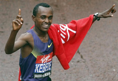 Olympic bronze medallist Tsegaye Kebede of Ethiopia celebrates after winning his seventh successive London men's marathon title in London Ap