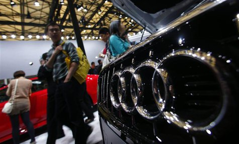 People look at Audi cars during the 15th Shanghai International Automobile Industry Exhibition in Shanghai April 21, 2013. REUTERS/Carlos Ba