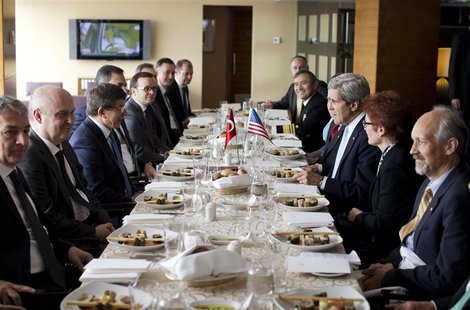 Turkish Foreign Minister Ahmet Davutoglu (3rd L) meets with U.S. Secretary of State John Kerry (3rd R) during a luncheon in Istanbul April 2