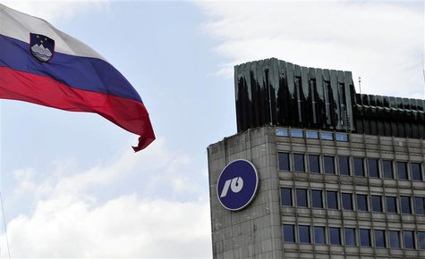 Slovenia's national flag flutters next to Nova Ljubljanska Banka (NLB) building in Ljubljana, July 23, 2012. REUTERS/Srdjan Zivulovic