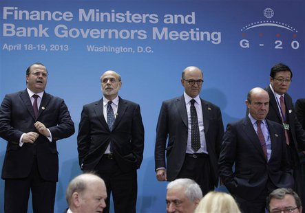 Finance ministers and central bank governors from the G20 arrive for a family photo during the 2013 Spring Meeting of the International Mone