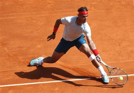Rafael Nadal of Spain returns the ball to Novak Djokovic of Serbia during their final match at the Monte Carlo Masters in Monaco April 21, 2