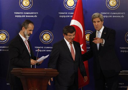 Turkish Foreign Minister Ahmet Davutoglu (C), U.S. Secretary of State John Kerry (R) and Syrian opposition leader Moaz al-Khatib leave a new