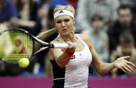 Russia's Maria Kirilenko hits a return against Slovakia's Daniela Hantuchova during their Fed Cup World Group semi-final tennis match in Mos
