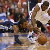 Los Angeles Clippers Chris Paul (R)and Memphis Grizzlies go after a loose ball during Game 1 of their NBA Western Conference Quarterfinals b