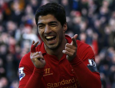 Liverpool's Luis Suarez celebrates his goal against Chelsea during their English Premier League soccer match at Anfield in Liverpool, northe