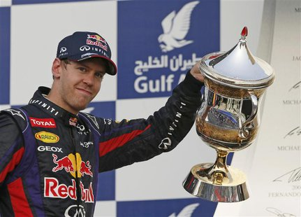 Red Bull Formula One driver Sebastian Vettel of Germany celebrates with the winner's trophy during the victory ceremony of the Bahrain F1 Gr